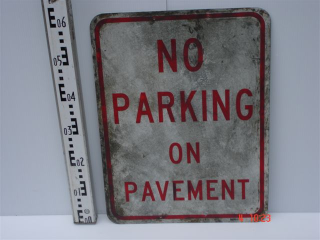 American sign - No parking on pavement