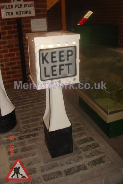 Period Street Dressing - Keep Left sign